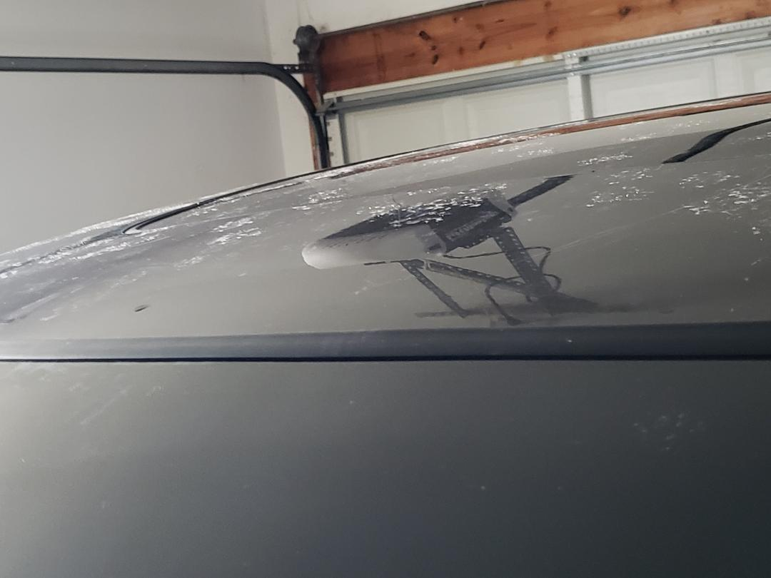 Windshield Leak caused by Windshield repair company-pic13-_looks-like-seal-raised-up-middle.jpg