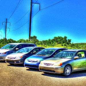 Taken in 2015. From right to left: our 3 Civics: Juliet's, Michelle's and Agi's and my Odyssey. We're Honda crazy :